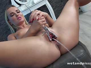 Stunning babe Victoria Pure is pissing and playing far her wet seize