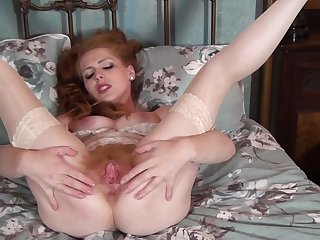 Adorable redhead dame Tia Jones drops their way lacklustre panties with regard to play